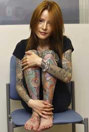 日本黑帮纹身图片_日本黑帮女自传畅销欧美 展示全身纹身_资讯_凤凰网