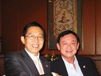 吕宁思与泰国前总理他信
