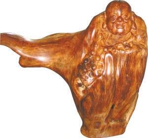 国家一级保护植物海黄和古沉木雕(图)